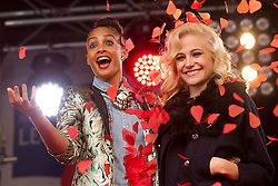 © Licensed to London News Pictures. 24/10/2012. LONDON, UK. Singers Pixie Lott (R) and Alesha Dixon (R)  are showered with poppies at the launch of the Royal British Legion's 2012 Poppy Appeal in Trafalgar Square, London, today (24/10/12).  Photo credit: Matt Cetti-Roberts/LNP