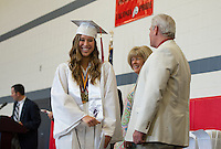 Emma Rose Horton is all smiles as she receives her diploma during Laconia High School's 135th commencement ceremony at Laconia Middle School Saturday morning.  (Karen Bobotas/for the Laconia Daily Sun)