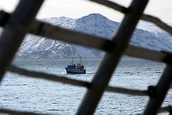 Norway Hammerfest 24MAR07 - Fishing boat in the Barents Sea seen through traditional cod drying racks near Hammerfest, the world's most northerly town...jre/Photo by Jiri Rezac..© Jiri Rezac 2007..Contact: +44 (0) 7050 110 417.Mobile:  +44 (0) 7801 337 683.Office:  +44 (0) 20 8968 9635..Email:   jiri@jirirezac.com.Web:    www.jirirezac.com..© All images Jiri Rezac 2007 - All rights reserved.