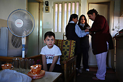 Mohammed Haitham Obeidi, 7, is seen at home with his mother and sisters in Amman, Jordan, Aug. 20, 2007. His family fled Iraq after threats were made on his father's life. They are now awaiting asylum.