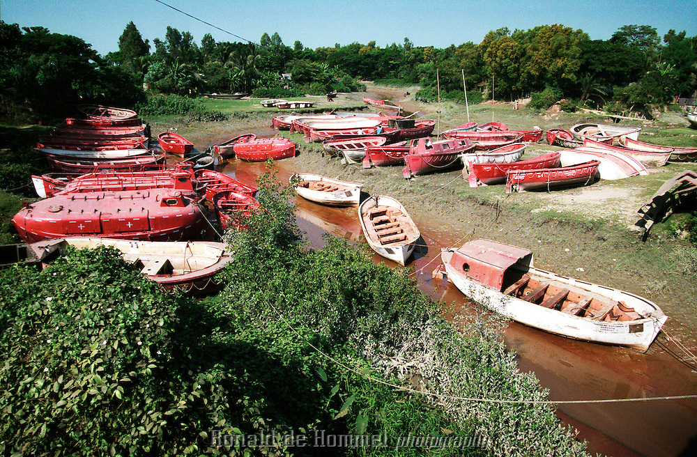 Lifeboats in a creek, for sale, close to the road that passes several shipbreaking yards