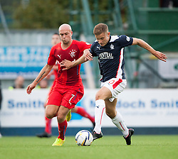Rangers Nicky Law and Falkirk's Alex Cooper. Falkirk 0 v 2 Rangers, Scottish Championship game played 15/8/2014 at The Falkirk Stadium.