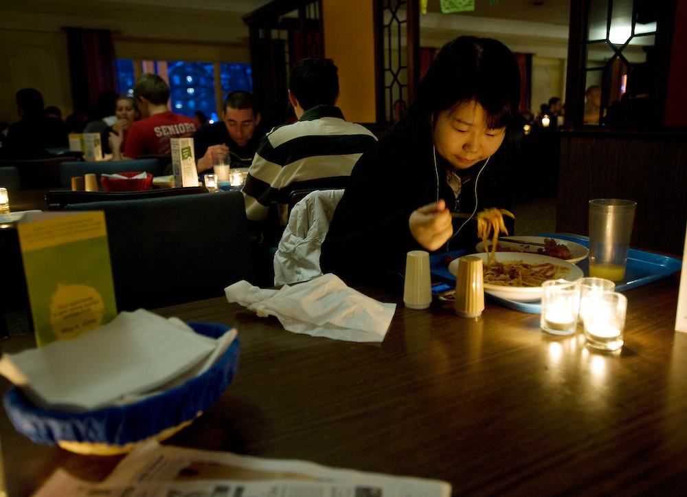Yugin Jiao, an exchange student from China enjoys dinner by candlelight in Nelson Commons. ....Conservation Dinner: Wednesday, February 25th,  Nelson Dining Hall will enjoy the first candlelit dinner at Nelson