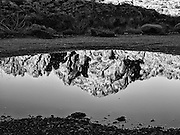 Red rock formations near Mouse's Tank Trail, Valley of Fire State Park, Nevada reflected in a puddle. Valley of Fire, the oldest and largest state park in Nevada, dedicated in 1935, is located in the Mojave Desert in southern Nevada.