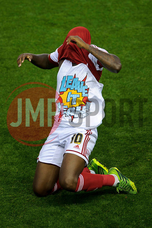"Bristol City Midfielder Jay Emmanuel-Thomas (ENG) celebrates scoring a goal by revealing a tshirt that reads ""leave it yeah!""during the first half of the match - Photo mandatory by-line: Rogan Thomson/JMP - Tel: 07966 386802 - 04/09/2013 - SPORT - FOOTBALL - Ashton Gate, Bristol - Bristol City v Bristol Rovers - Johnstone's Paint Trophy - First Round - Bristol Derby"