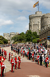 Household Cavalry guards stand guard before the annual Order of the Garter Service at St George's Chapel, Windsor Castle.