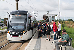 People waiting to board new Edinburgh tram at Ingleston park and Ride in Edinburgh, Scotland, United Kingdom.