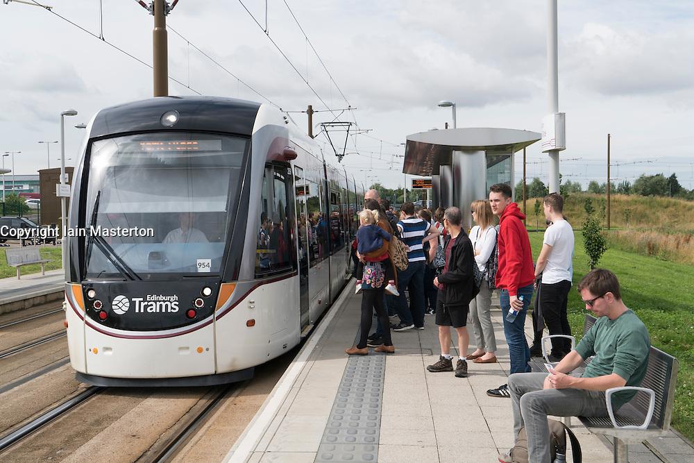 People waiting to board new Edinburgh tram at Ingleston park and Ride in Edinburgh, Scotland, United Kingdom.