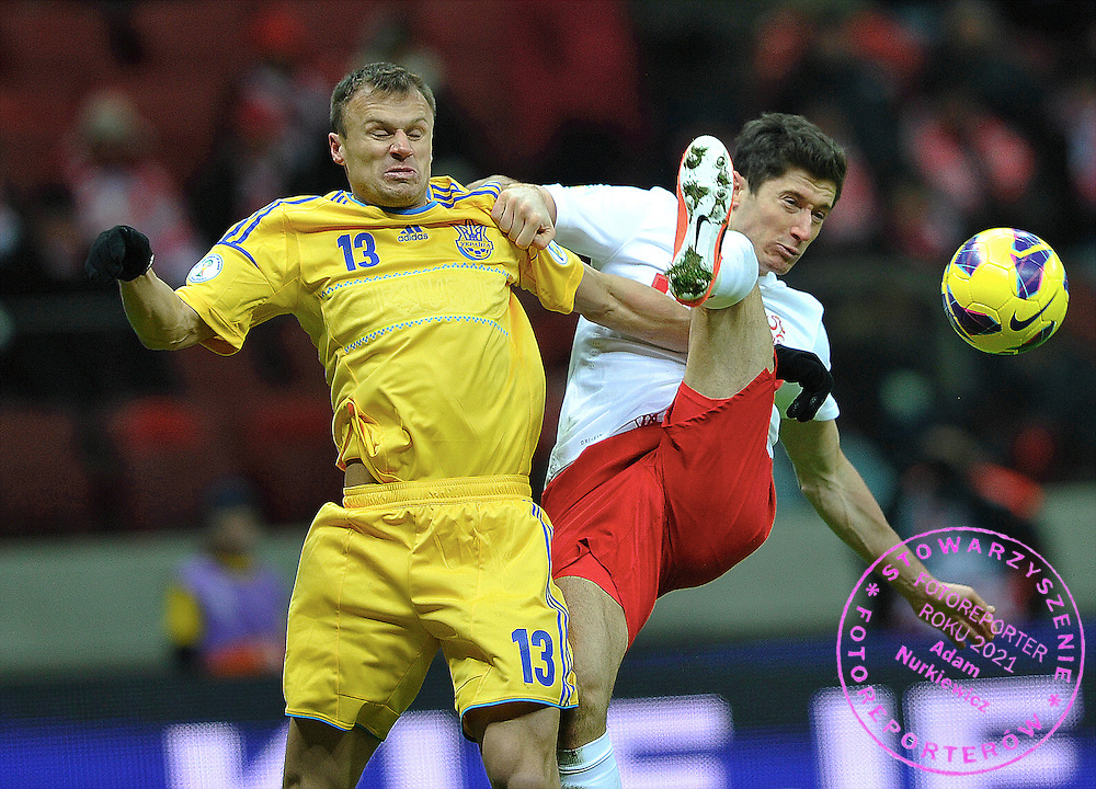 Warsaw 22/03/2013.Poland vs Ukraine FIFA 2014 World Cup qualifying football match in Warsaw, on March 22, 2013.Ukraine's Wiaczeslaw Szewczuk fights for ball with Poland's Robert Lewandowski (R).Photo by : Piotr Hawalej