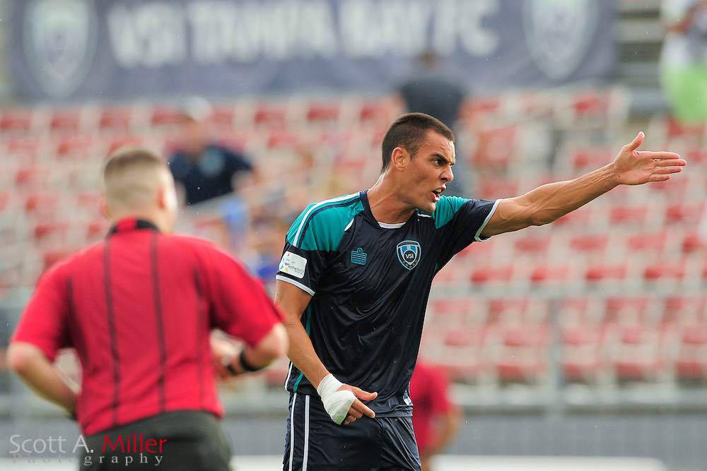 VSI Tampa Bay FC forward Mauricio Salles (23) argues for a hand ball against the Phoenix FC Wolves in a USL Pro soccer match at Plant City stadium in Plant City, Florida on June 9, 2013.<br /> <br /> &copy;2013 Scott A. Miller