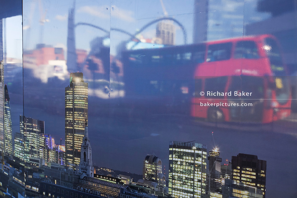 An artwork showing a nightltime City of London's skyline with the sunny junction of Old Street roundabout and red bus.