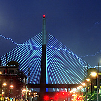 Lightning strikes over and behind Boston's Zakim Bridge