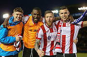 Lincoln City Forward Theo Robinson, Lincoln City Midfielder Alan Power and Lincoln City Forward Jack Muldoon celebrate after victory in the The FA Cup fourth round match between Lincoln City and Brighton and Hove Albion at Sincil Bank, Lincoln, United Kingdom on 28 January 2017. Photo by Phil Duncan.