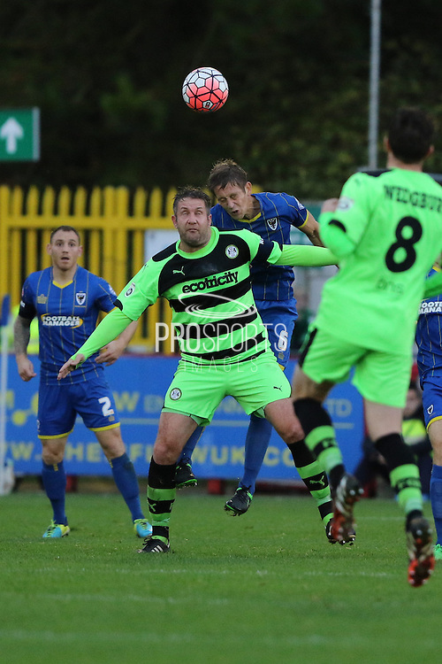 Paul Robinson of AFC Wimbledon and Jon Parkin during the The FA Cup match between AFC Wimbledon and Forest Green Rovers at the Cherry Red Records Stadium, Kingston, England on 7 November 2015. Photo by Stuart Butcher.