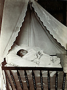 memorial portrait of dead baby in crib 1929