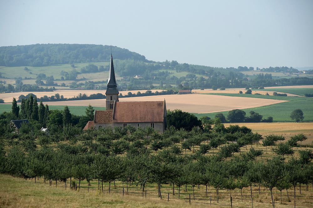 Un paysage de vergers, bocages et un &eacute;glise typique du Pays d'Auge.<br /> Vieux Pont, France.<br /> 26/07/2013.