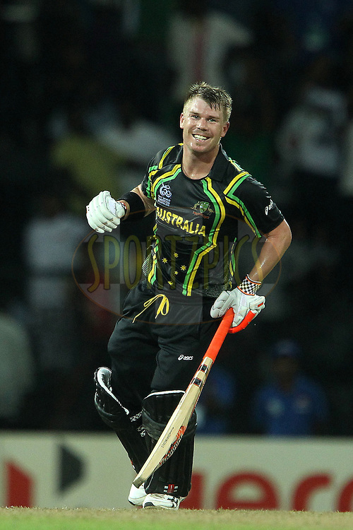 David Warner celebrates the win for Australia during the ICC World Twenty20 Super 8s match between Australia and India held at the Premadasa Stadium in Colombo, Sri Lanka on the 28th September 2012..Photo by Ron Gaunt/SPORTZPICS