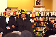 Andrew Reitz escorts model Barbara Bostick to the runway during the Crowns Hat Fashion Show at Books & Company in The Greene in Beavercreek, Saturday, February 23, 2013.
