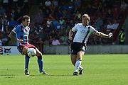 Tony Craig  shoots towards goal during the Sky Bet League 1 match between Scunthorpe United and Millwall at Glanford Park, Scunthorpe, England on 22 August 2015. Photo by Ian Lyall.