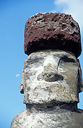 Giant Moai, huge statue made from Polynesians on Easter Island the moon in the background,Chile, South America