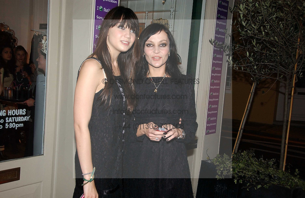 Left to right, DAISY LOWE and PEARL LOWE at a party to launch Pearl Lowe's fashion held at The Cross. 141 Portland Road, Holland Park, W11 on 30th October 2006.<br />