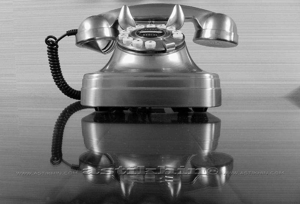 Old landline telephone. Phone on a gray background.