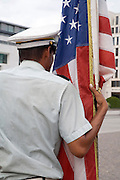 soldier holding the American flag
