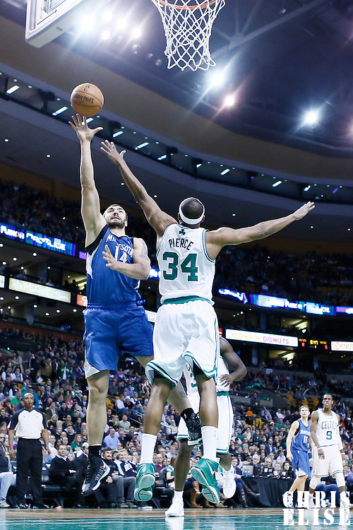 05 December 2012: Minnesota Timberwolves center Nikola Pekovic (14) goes for the skyhook over Boston Celtics small forward Paul Pierce (34) during the Boston Celtics 104-94 victory over the Minnesota Timberwolves at the TD Garden, Boston, Massachusetts, USA.