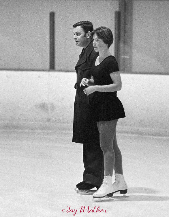 Dorothy Hamill practices at the Colorado Ice Arena in Denver, Colorado in 1975 prior to the 1976 Winter Olympics in Innsbruck, Austria where she won the gold medal in women's figure skating.  Her coach Carlo Fassi was at the practice session.