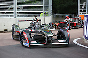 Jerome D'Ambrosio closely followed by a mahindra racing during the FIA Formula E Visa London ePrix  at Battersea Park, London, United Kingdom on 28 June 2015. Photo by Matthew Redman.