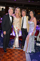 Left to right, SIR BRUCE FORSYTH, PENNY LANCASTER, ROD STEWART and LADY FORSYTH at The Butterfly Ball in aid of Caudwell Children held at the Grosvenor House, Park Lane, London on 25th June 2015