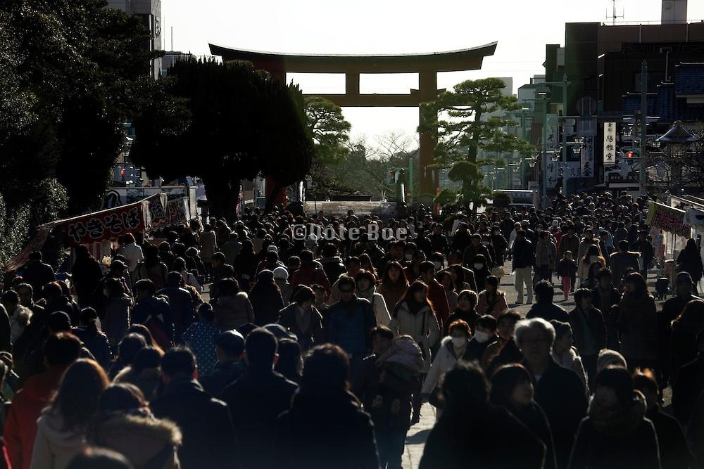 Kamakura Japan the Hachimangu shrine torii and a  very large crowd of people