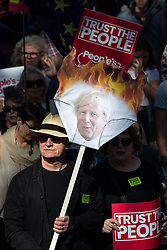 © Licensed to London News Pictures . 21/09/2019. Brighton, UK. A pair of underpants on fire with the face of Prime Minister Boris Johnson . Thousands attending a march organised by the People's Vote for a second EU referendum on Brexit pass through Brighton and along the Promenade during the first day of the 2019 Labour Party Conference from the Brighton Centre . Photo credit: Joel Goodman/LNP