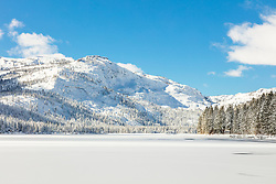 """Snow Covered Donner Lake 1"" - Photograph of a mostly iced over and snow covered Donner Lake, Donner Summit can be seen in the background."