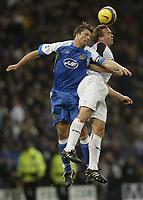 Photo: Aidan Ellis.<br /> Bolton Wanderers v Wigan Athletic. The Barclays Premiership. 04/11/2006.<br /> Wigan's Arjun de Zeeuw (L) battles with Bolton's Kevin Davis