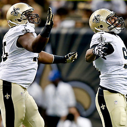 Sep 22, 2013; New Orleans, LA, USA; New Orleans Saints defensive end Cameron Jordan (94) celebrates with teammate defensive end Tyrunn Walker (75) after sacking Arizona Cardinals quarterback Carson Palmer (not pictured) during a game at Mercedes-Benz Superdome. The Saints defeated the Cardinals 31-7. Mandatory Credit: Derick E. Hingle-USA TODAY Sports