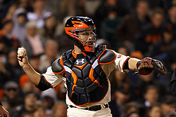 May 24, 2011; San Francisco, CA, USA;  San Francisco Giants catcher Buster Posey (28) throws to the pitchers mound against the Florida Marlins during the eighth inning at AT&T Park. Florida defeated San Francisco 5-1.