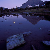 Mout Reynolds and the full moon at dusk. Glacier National Park, Montana.