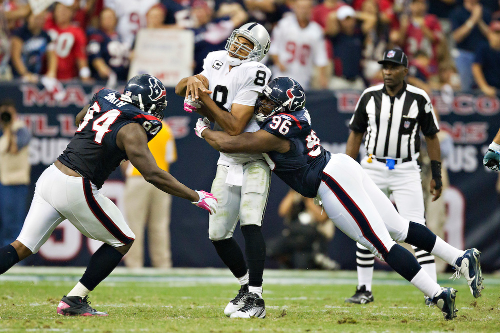 HOUSTON, TX - OCTOBER 9:   Jason Campbell #8 of the Oakland Raiders throws a pass under pressure from Tim Jamison #96 of the Houston Texans at Reliant Stadium on October 9, 2011 in Houston, Texas.  The Raiders defeated the Texans 25 to 20.  (Photo by Wesley Hitt/Getty Images) *** Local Caption *** Jason Campbell; Tim Jamison