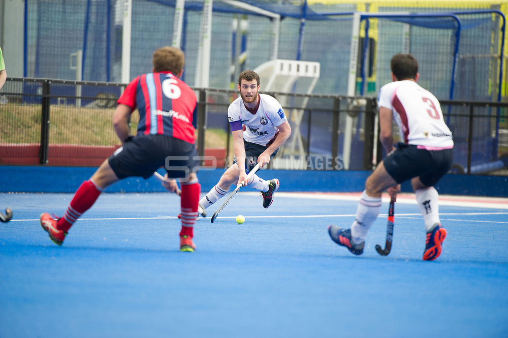 Wimbledon's Johnny Kinder looks for a pass. Wimbledon v Hampstead & Westminster - Semi-Final - Men's Hockey League Finals, Lee Valley Hockey & Tennis Centre, London, UK on 22 April 2017. Photo: Simon Parker