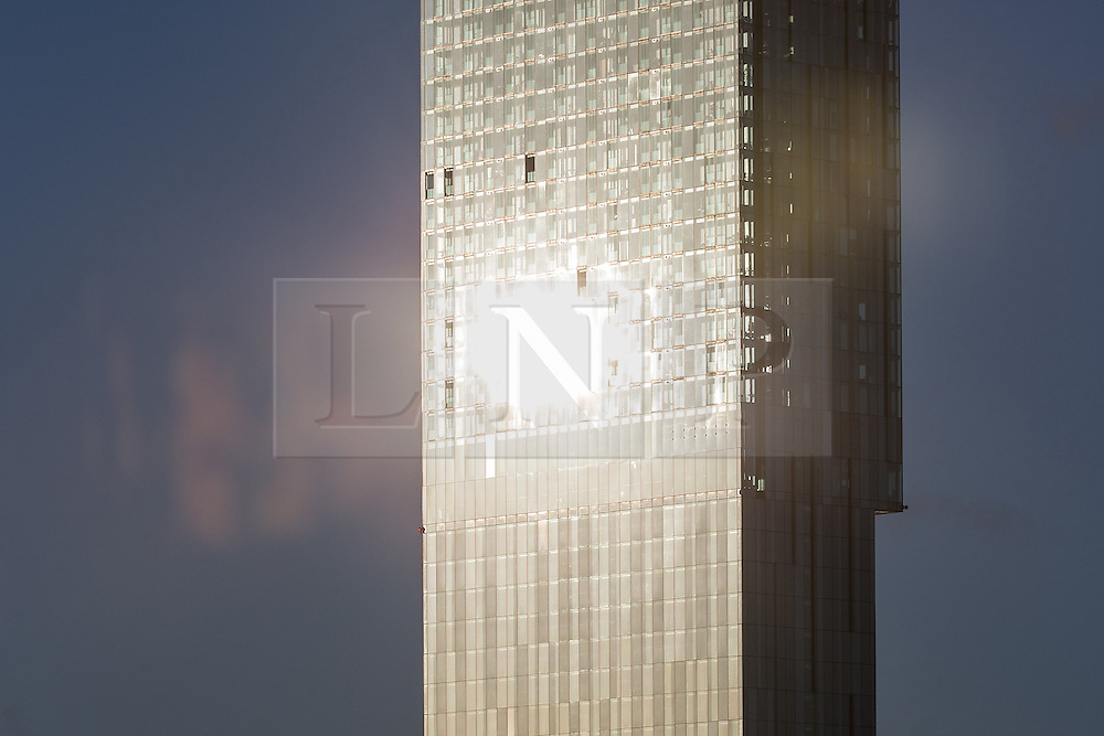 © Licensed to London News Pictures . 27/02/2014 . Manchester , UK . Manchester's iconic Beetham Tower reflects low , bright spring sunshine across the city . Bright sunshine and spring-like weather in the North West of England . Photo credit : Joel Goodman/LNP