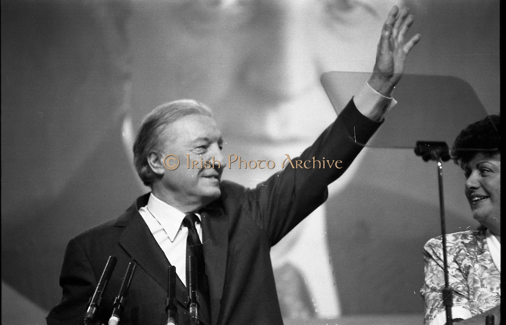 Fianna Fáil Ard Fheis.  (R97)..1989..25.02.1989..02.25.1989..25th February 1989..The Fianna Fáil Ard Fheis was held today at the RDS Main Hall, Ballsbridge, Dublin. An Taoiseach, Charles Haughey TD,gave the keynote speech of the event...An Taoiseach, Charles Haughey TD, is pictured as he takes place at the podium, he is accompanied by  Minister Máire Geoghegan-Quinn