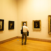 A visitor enjoys the art work at the National Gallery of Ireland in Dublin.