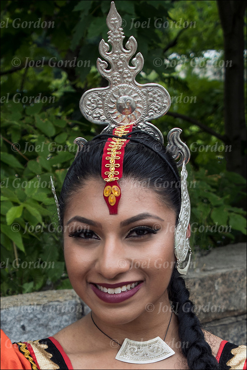 Kandysan Sri Lankan dancer showing her ethnic pride.<br /> <br /> The group preformed at &quot;Drums Along the Hudson&quot; a Native American and Multicultural Celebration in Inwood Hill Park, NYC.  <br /> <br /> The Sri Lankan Dance Academy of NY is a dance school and performing ensemble, promoting cultural harmony between communities of Sri Lankan heritage.