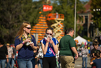 Pumpkins, food, games and perfect weather by day and night brought crowds to downtown Laconia from day to night for Pumpkin Fest.  (Karen Bobotas/for the Laconia Daily Sun)