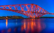 The Forth Bridge during twilight – a magnificent railway bridge.