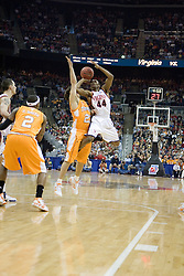 Virginia Cavaliers point guard Sean Singletary (44) is fouled on a jump shot by Tennessee Volunteers guard Dane Bradshaw (23).  The #4 seed Virginia Cavaliers were defeated by the #5 seed Tennessee Volunteers 77-74 in the second round of the Men's NCAA Tournament in Columbus, OH on March 18, 2007.