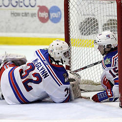 Oakville, ON  - Feb 1 : Ontario Junior Hockey League game action between the Oakville Blades vs Aurora Tigers. Brendan McGlynn #32 of the Oakville Blades Hockey Club with Sean Kohler #15 in the net after Aurora's second goal. <br /> (Photo by Kevin Sousa / OJHL Images)