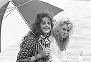 Trini Woodall and Katy Braine on boat. Luch party hosted by tony Hickox. Henley. 3 July 1982. . © Copyright Photograph by Dafydd Jones 66 Stockwell Park Rd. London SW9 0DA Tel 020 7733 0108 www.dafjones.com