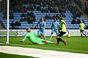 Peterborough United forward Matt Godden (9) forces a save from Coventry City goalkeeper Lee Burge (1)   during the EFL Sky Bet League 1 match between Coventry City and Peterborough United at the Ricoh Arena, Coventry, England on 23 November 2018.